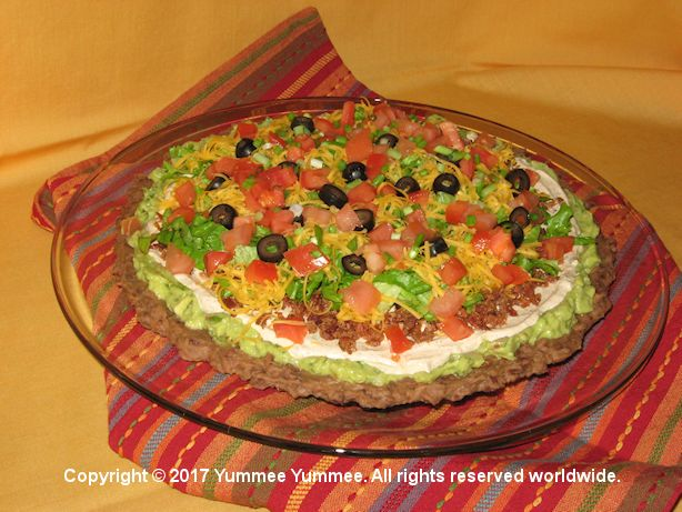 Layered Fiesta Dip is a great party dip. Open the tortilla chips and let your party guests have fun!