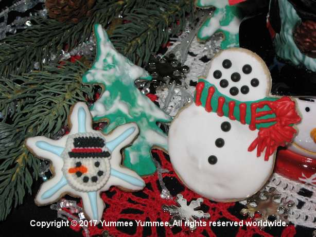 Warm up the kitchen and bake some cookies. Use your creativity to decorate a snowman and tree.